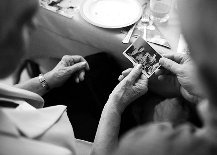 women look at old photograph