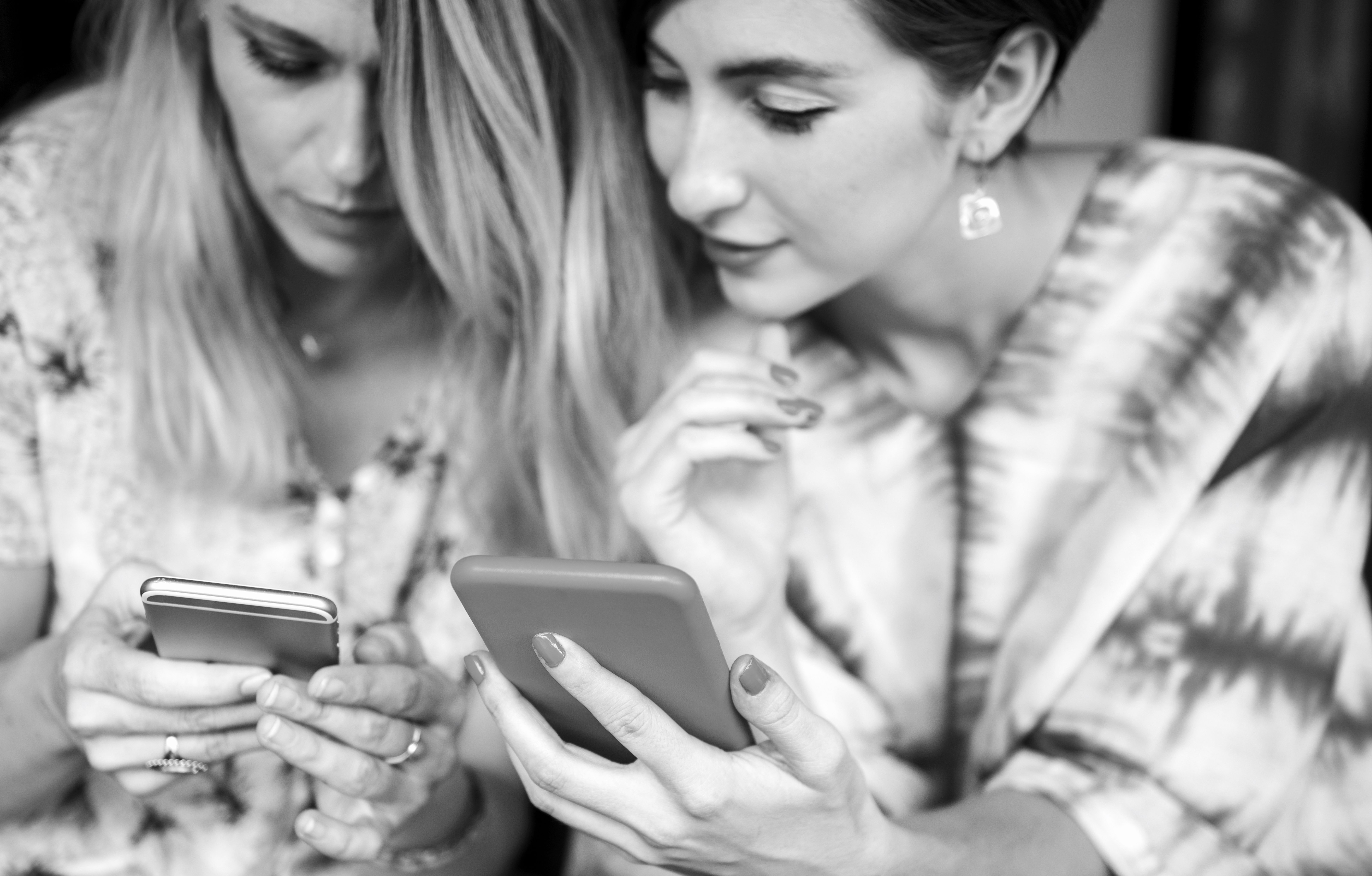 Two women looking at phones